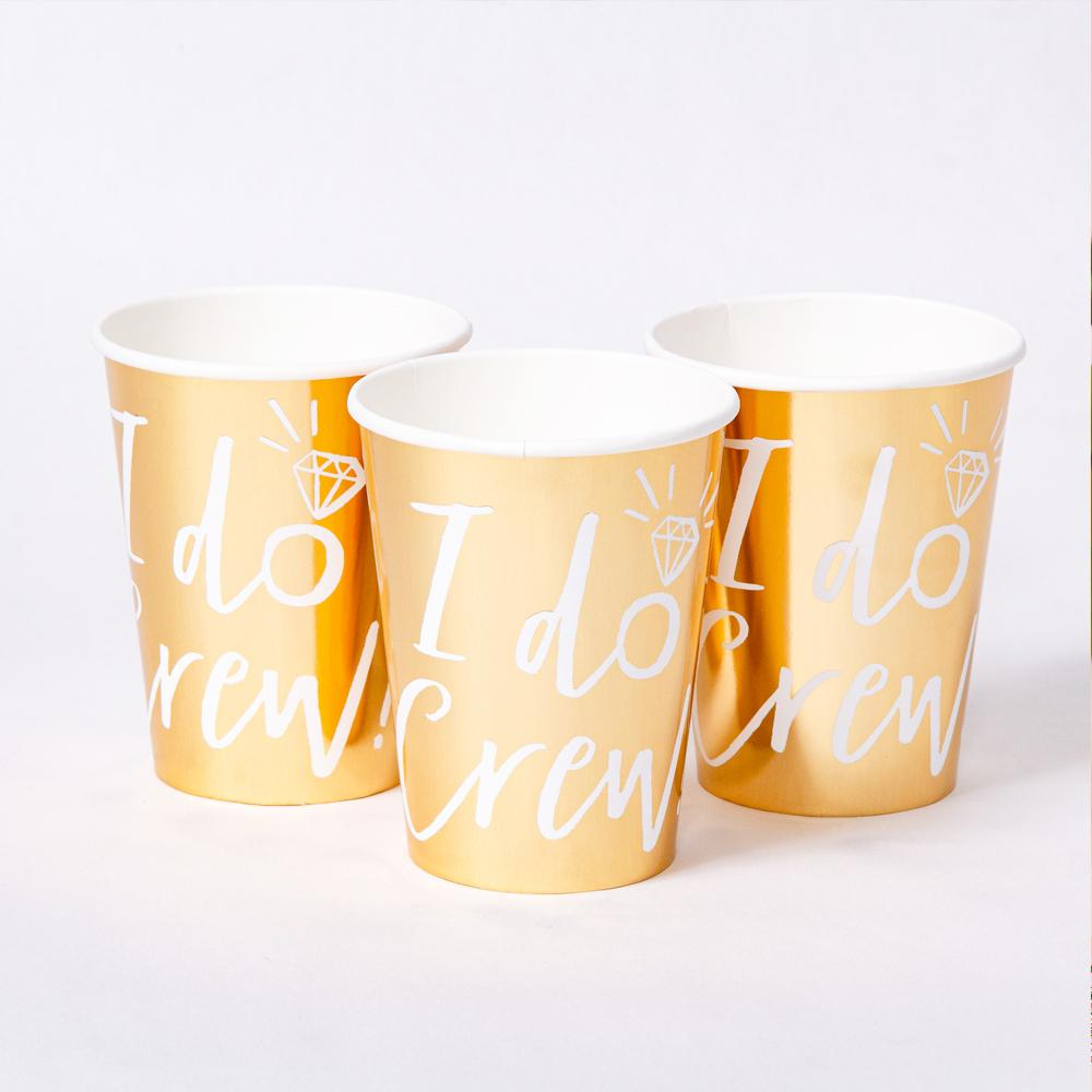 "3 shiny gold foil party cups with ""I Do Crew!"" written on the side"