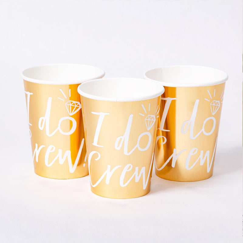 3 shiny gold foil party cups with