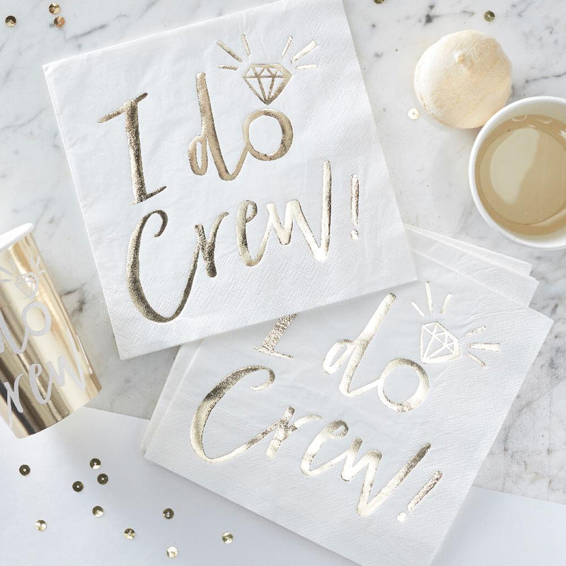 "Set of rose gold and white ""I Do Crew"" hen party napkins laid out flat"