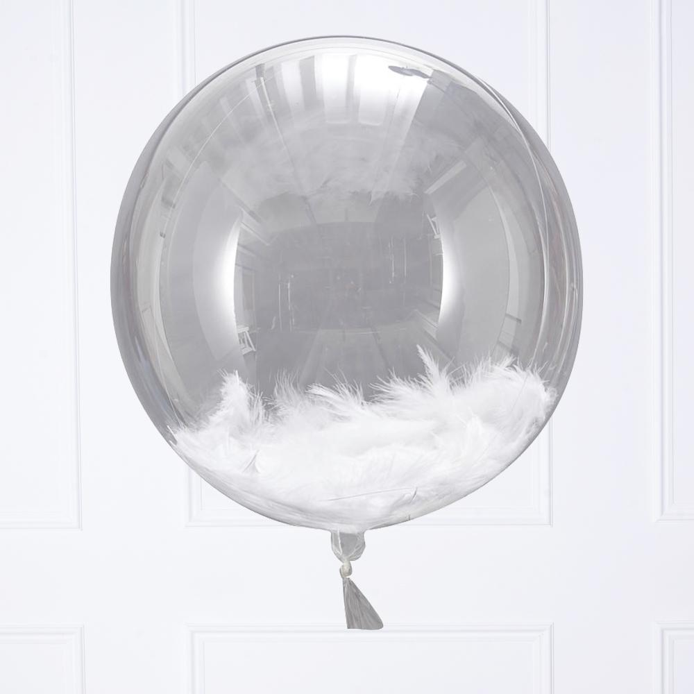 A large, clear, spherical balloon filled with fluffy white feathers