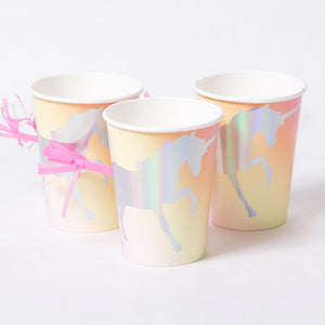 3 peach-coloured party cups with iridescent unicorn silhouettes