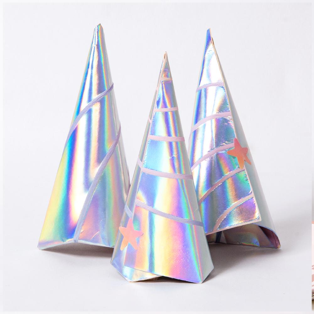 3 unicorn-horn shaped party napkins with a shimmery iridescent foil finish