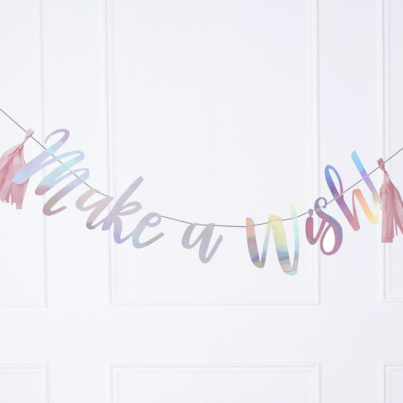 An iridescent party banner with a message saying