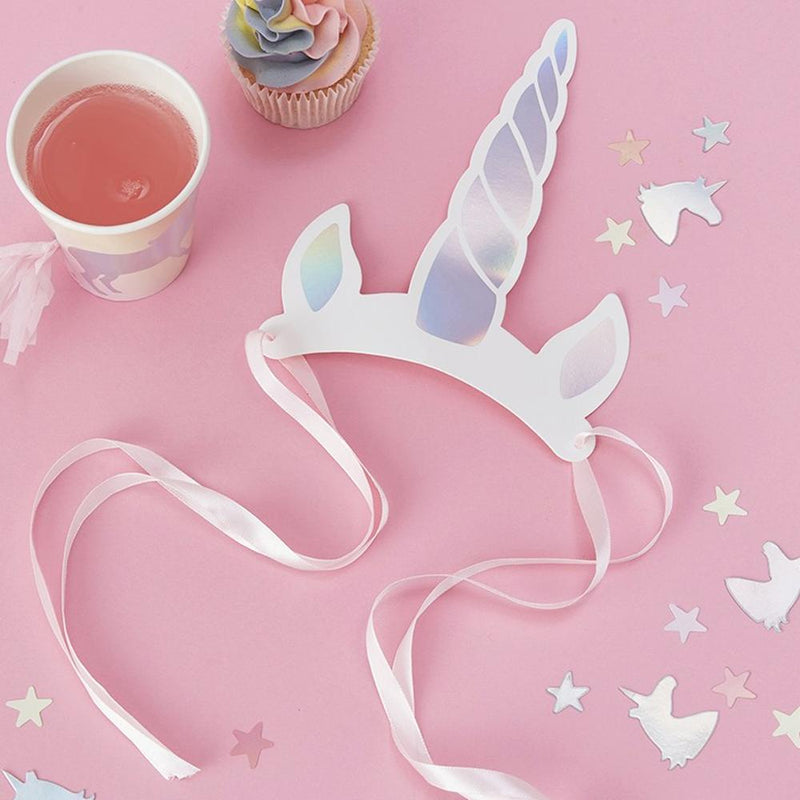 A unicorn horn headband with pink ribbon ties
