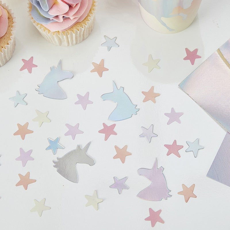 A scatter of unicorn-themed party confetti with an iridescent, pastel-coloured shine