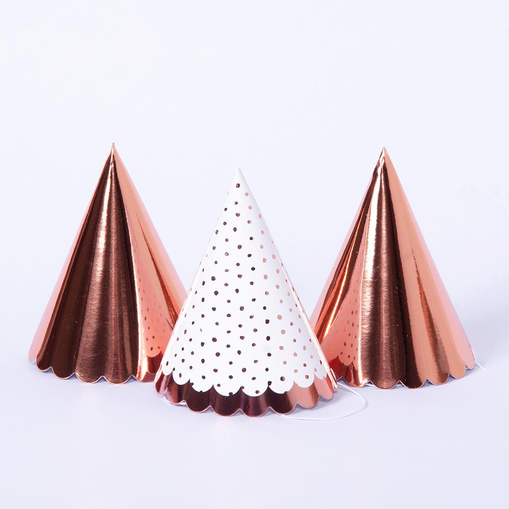 A set of stylish rose gold foil and polka dot party hats