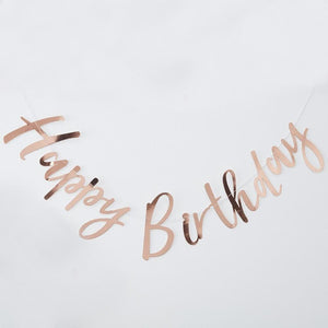 "A rose gold foiled party bunting with a ""Happy Birthday"" phrase"