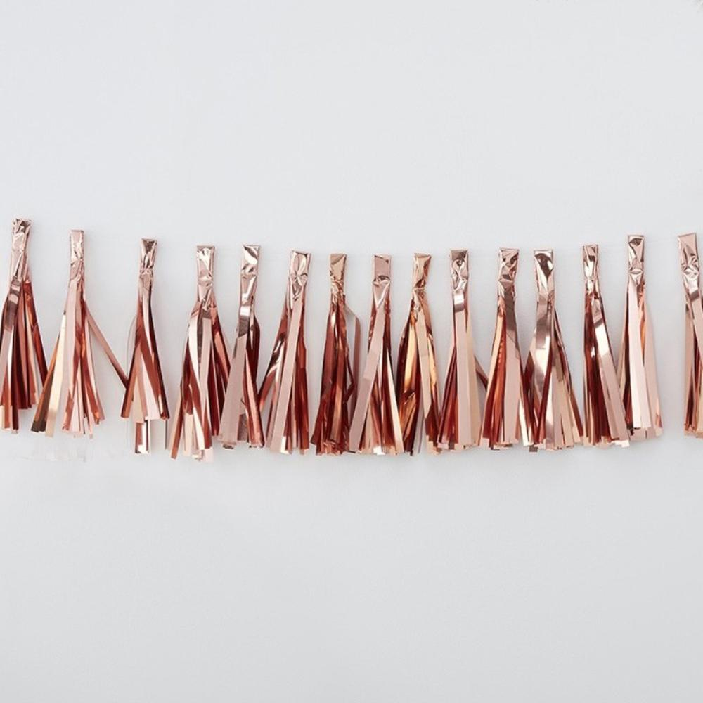 A rose gold party tassel garland