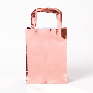 A shimmery rose gold foiled party gift bag