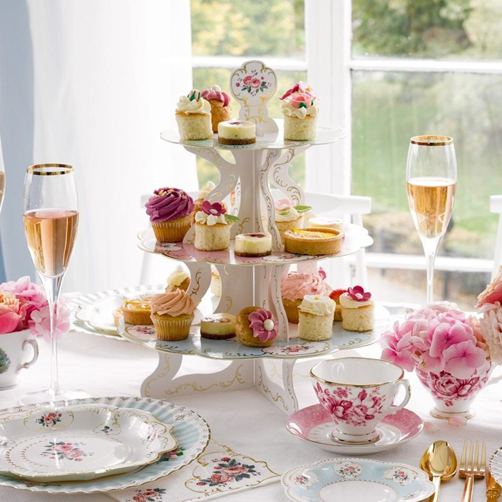 A cake stand adorned with cupcakes on a party table
