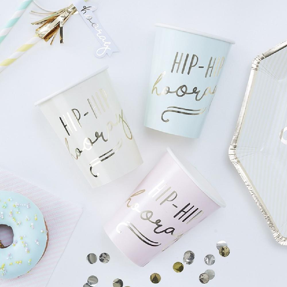 "A collection of pastel coloured party cups with a gold foil ""Hip Hip Hooray"" phrase"
