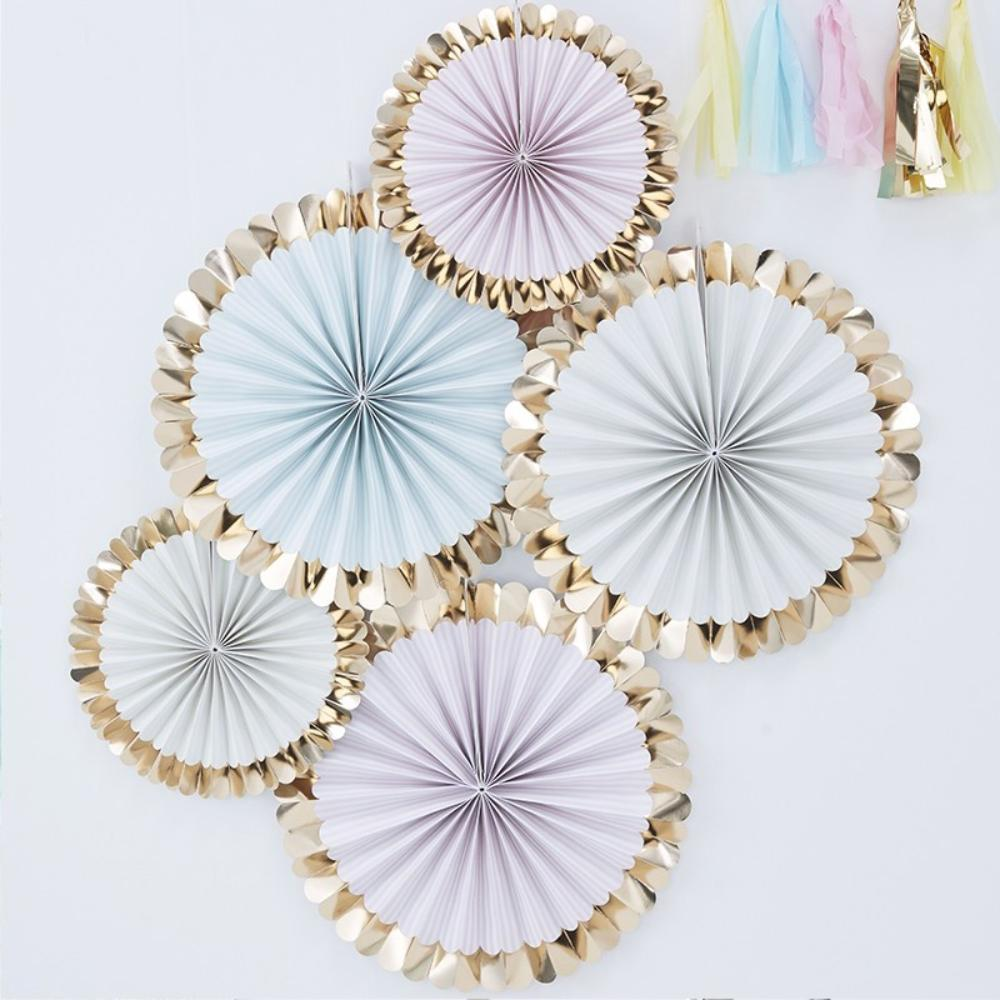 Pastel-coloured party fans with gold foil rims
