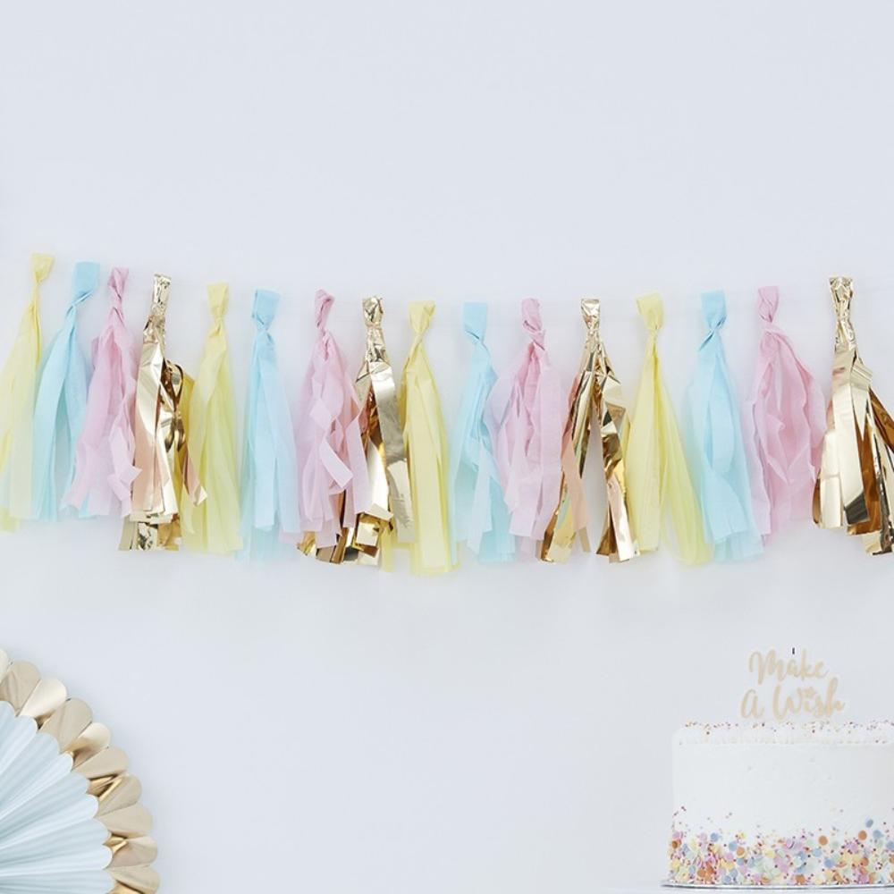 A party garland made up of pastel-coloured and gold foil tassels