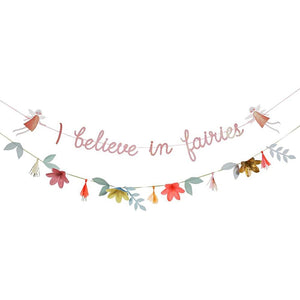 A fairy-themed party garland with foliage features and a foiled phrase