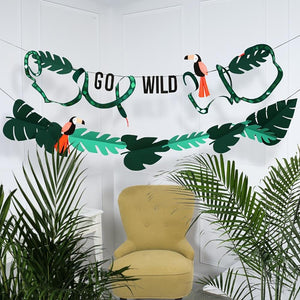 "A jungle-themed party garland adorned with the phrase ""Go Wild"" and animal shapes"