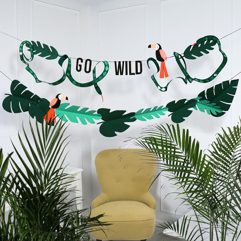 A jungle-themed party garland adorned with the phrase