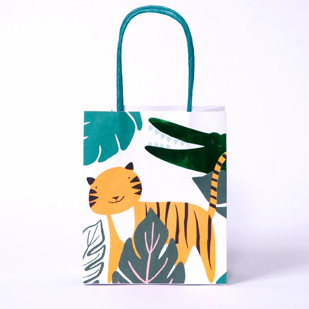 A jungle-themed party bag with a friendly tiger design