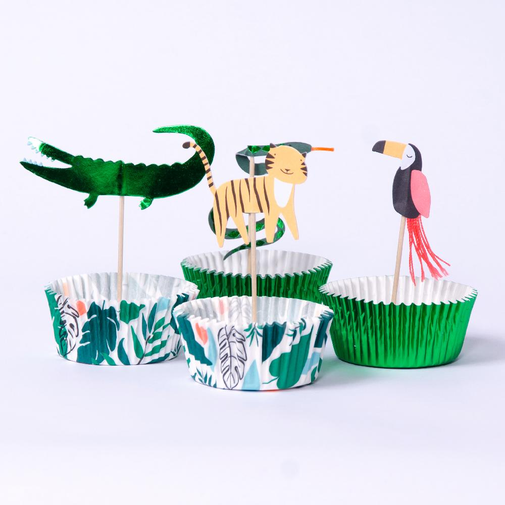 A set of jungle-themed cupcake supplies with jungle animal cake toppers