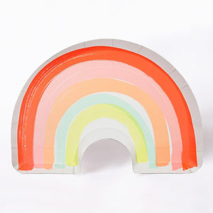 A rainbow-shaped party plate with soft-coloured stripes