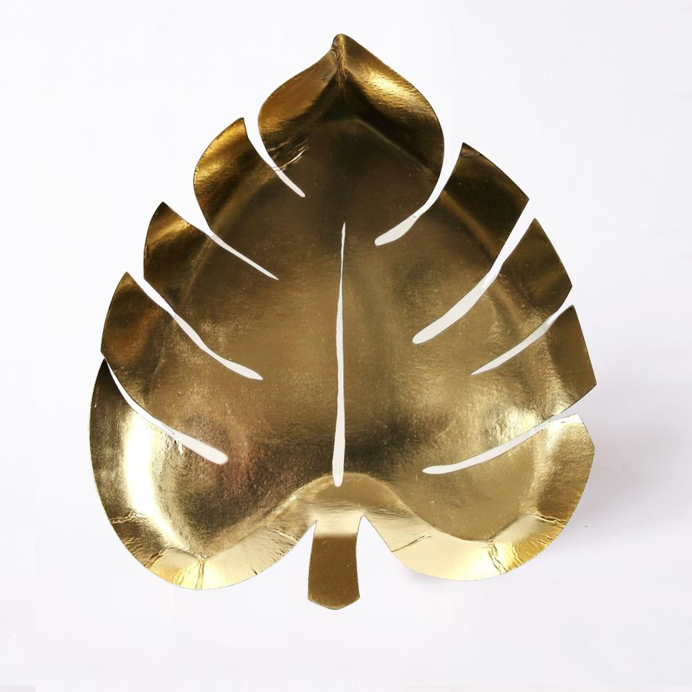 A leaf-shaped party plate with a shining gold-foil finish