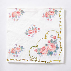 A square paper party napkin with an elegant floral design and gold foil filigree
