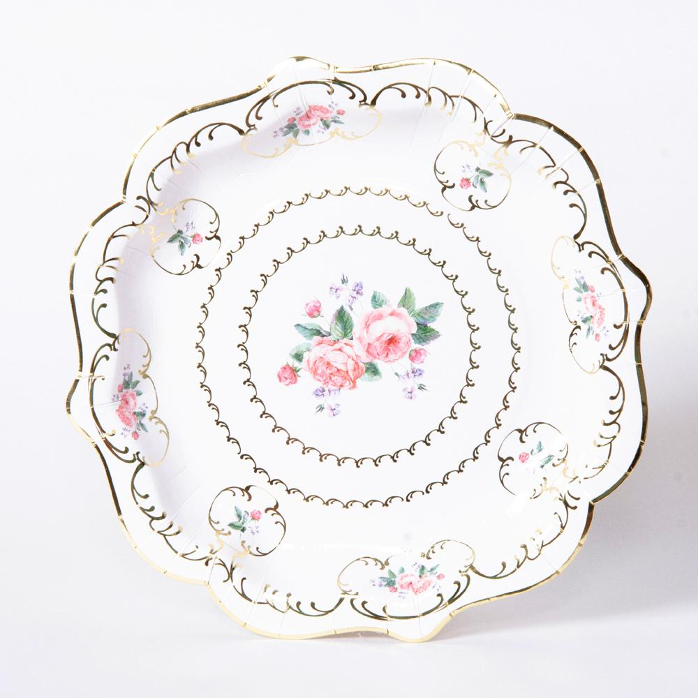 "A stylish party plate with floral decorations and a ""bone china"" design"
