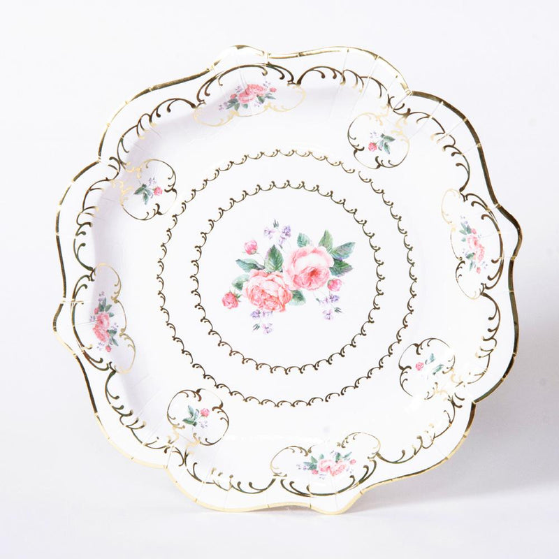 A stylish party plate with floral decorations and a