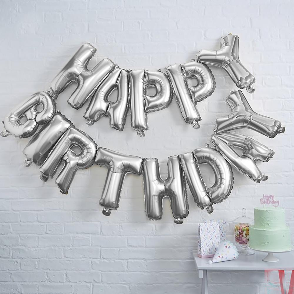 "A silver balloon garland with a ""Happy Birthday"" phrase"