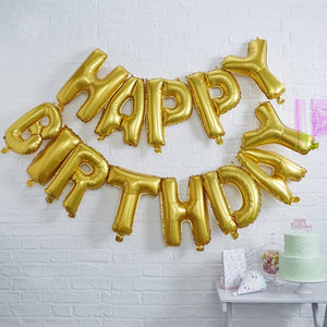 "A gold balloon garland with a ""Happy Birthday"" phrase"