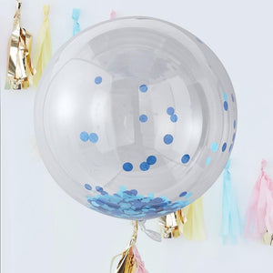 A large, spherical clear balloon filled with blue confetti pieces