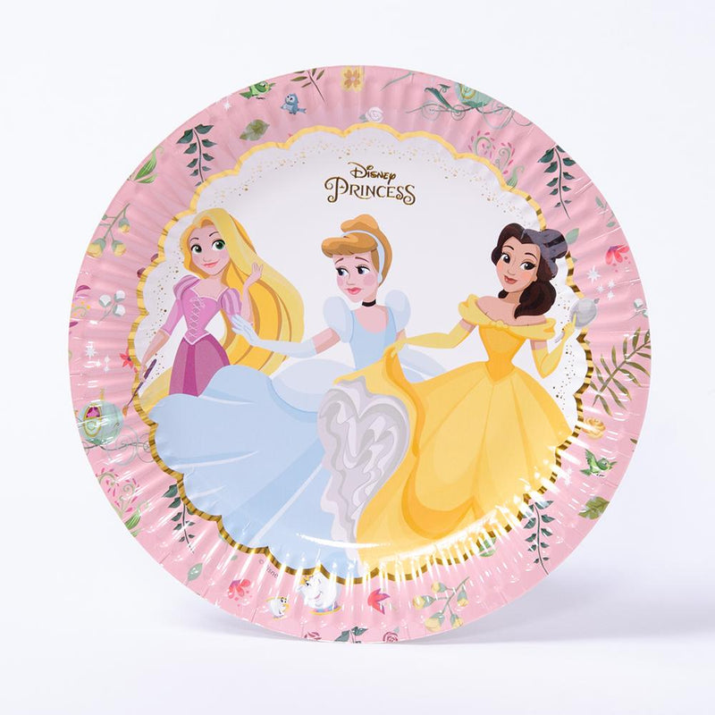 A paper party plate with cartoon illustrations of Belle, Cinderella, and Rapunzel