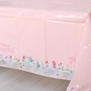 A pink table cover outlined with Disney-Princess designs and floral touches