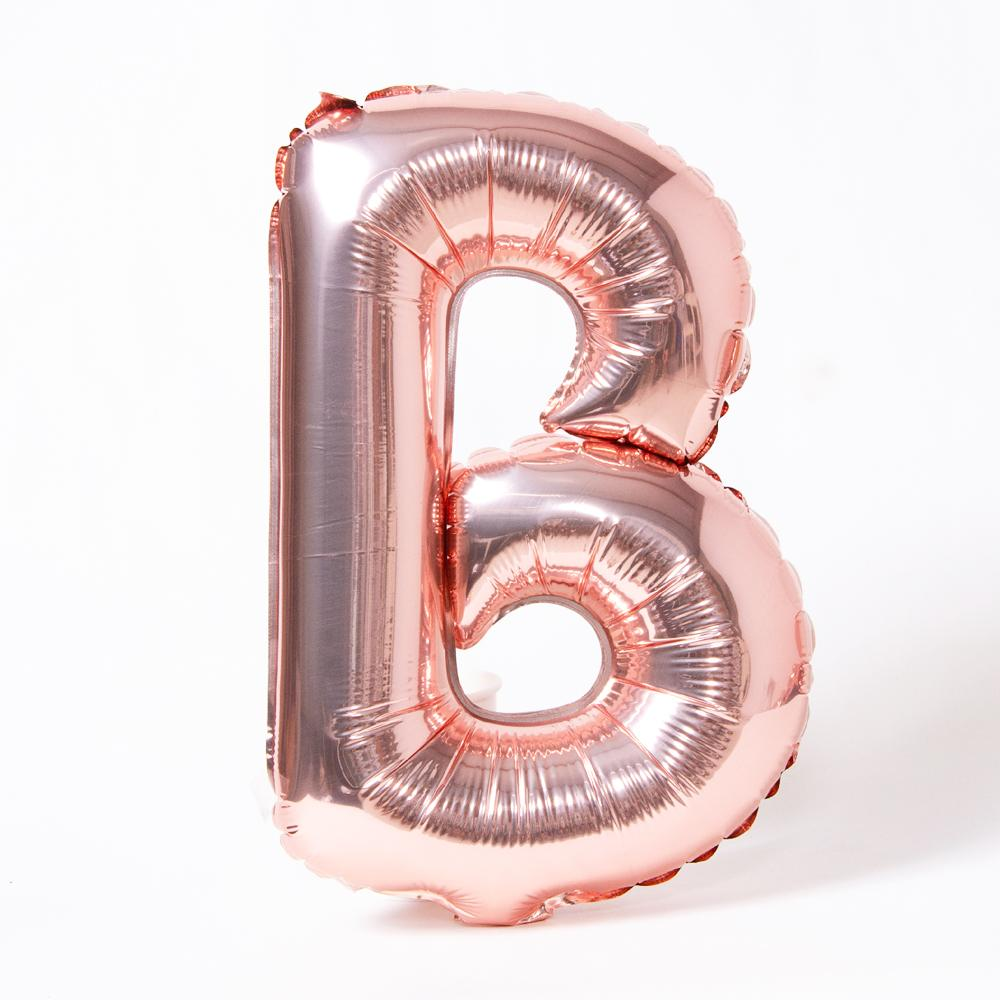 "A rose gold foil balloon in the shape of the letter ""B"""