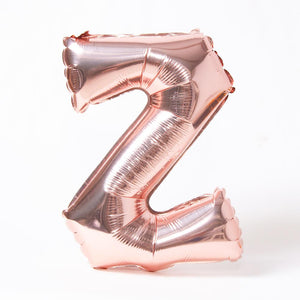 "A rose gold foil balloon in the shape of the letter ""Z"""