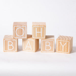 "A set of baby shower wooden baby blocks with the phrase ""Oh Baby"""