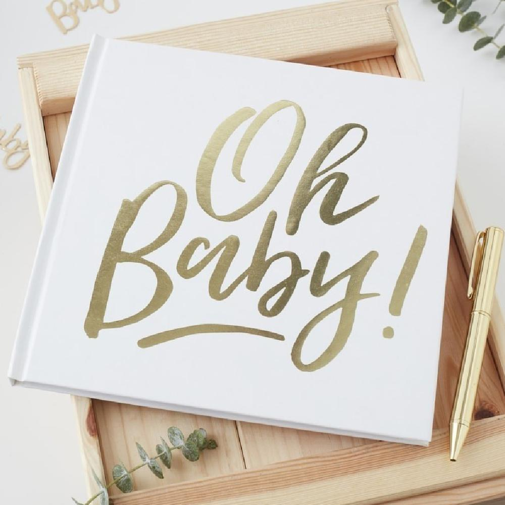 "A baby shower guestbook with a white cover and gold foil writing saying ""Oh Baby!"""