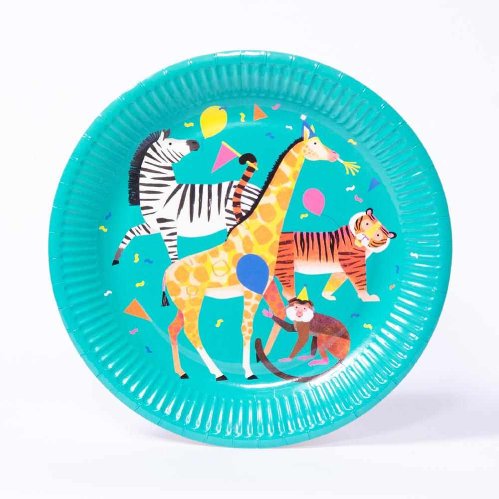 A round paper party plate featuring a collection of partying jungle animals