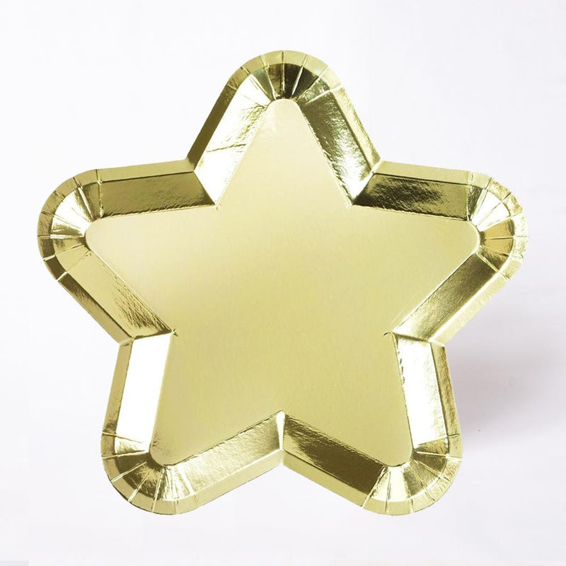 A star-shaped party plate covered in a shiny gold foil finish