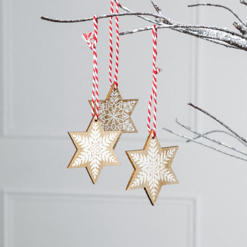Wooden snowflake Christmas tree decorations with candy cane colour twine