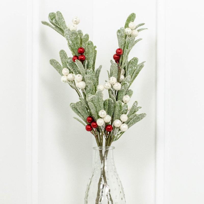 Sprigs of glittery mistletoe with white and red berries