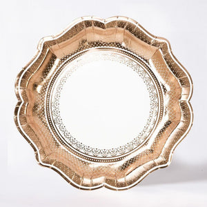 A vintage-styled rose gold paper party plate