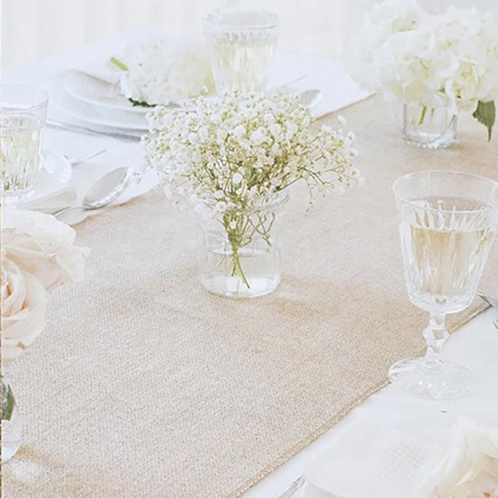 A table runner with a classic, rustic-style hessian colour and material