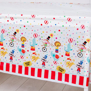 A Circus-themed table cover with cartoon character illustrations and white and red stripes