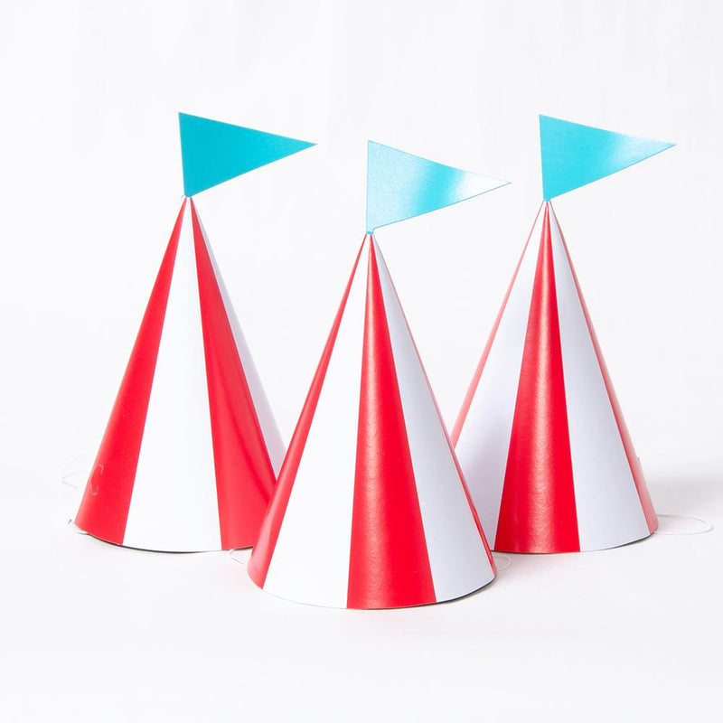 3 circus-party hats with red and white stripes and a blue flag