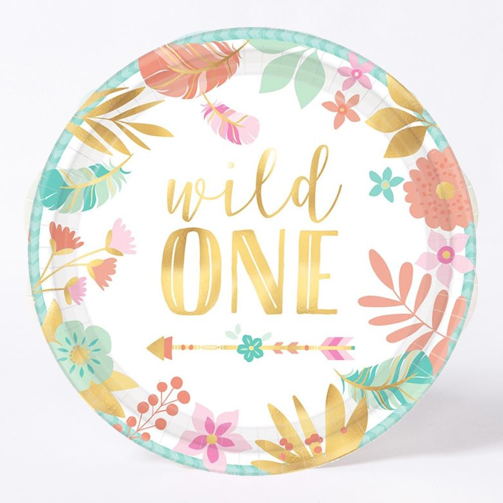 "A round party plate with a floral design and a ""Wild One"" phrase in gold lettering"