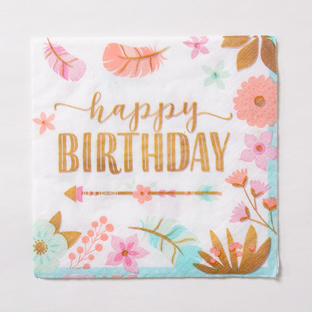 "A party napkin with a flower design and gold foil text saying ""Happy Birthday"""
