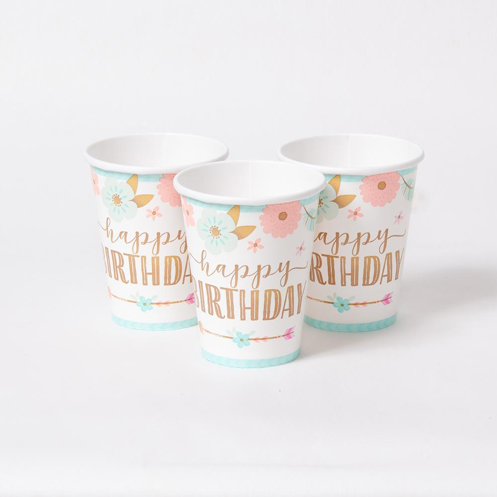 "3 paper party cups with a floral design and ""Happy Birthday"" written in gold foil"