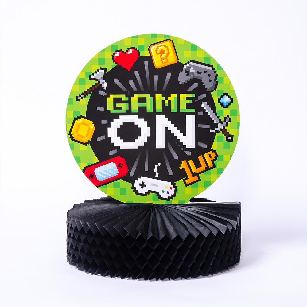 A gaming party centrepiece with a black honeycomb base and classic pixellated design