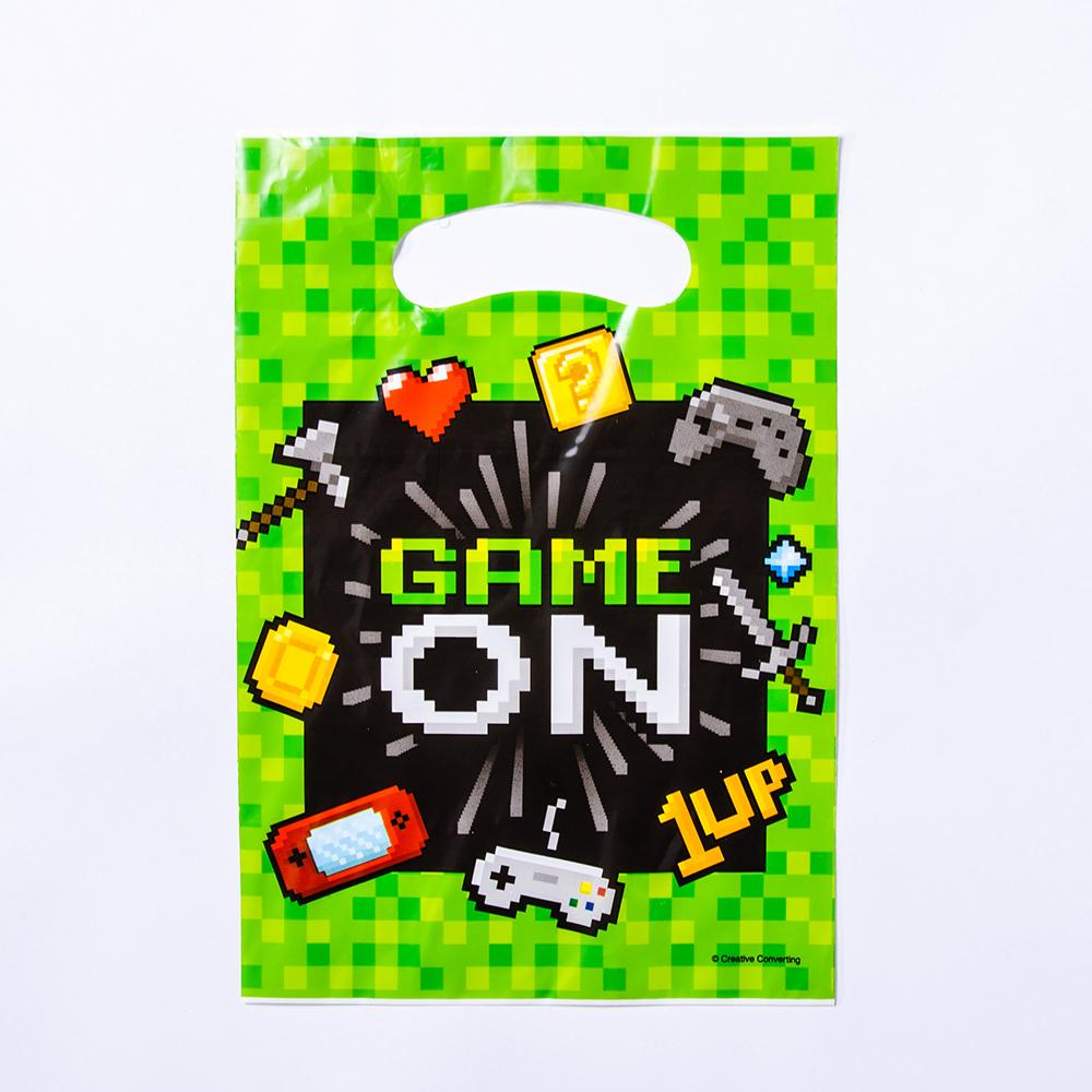 A pixelated-themed party bag with a classic game icon design