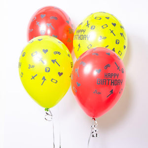 A bunch of 4 gaming party balloons with pixelated retro icons